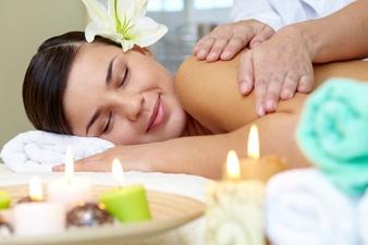 young-woman-enjoying-shoulders-massage_1098-2280